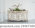 White ancient vintage commode with plants and 29467389