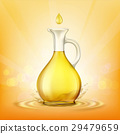 Glass jug with yellow oil and a spray of droplets. 29479659