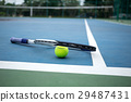 Tennis Ball and Racket on tennis court 29487431