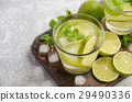 Refreshing summer drink with lime and mint  29490336