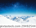 winter sky stars and the snow-capped mountains 29492544