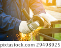 Worker in gloves cutting a steel rail 29498925
