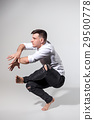 The young man dancing on gray 29500778