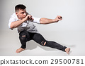 The young man dancing on gray 29500781