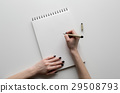 hands holding paper sheet or notebook and pen 29508793