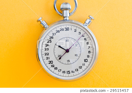 Retro style stopwatch chronometer on yellow paper 29515457
