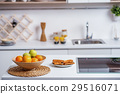 Healthy fruits in plate near electric stove at 29516071