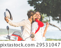 Portrait of happy young love couple on scooter 29531047