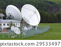 Satellite dishes in a countryside 29533497
