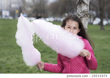 Picture of cute preteen girl eating cotton candy 29533974