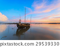 Wrecked fishing boat at sea with sunset 29539330