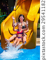 Swimming pool slides for family with children on 29541182