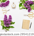 Lilac flowers, diary notebook, golden office   29541219