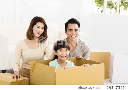 happy family holding box moving to new home 29547541