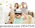 family with virtual reality headset  29547545