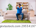 Man watching football at home sitting in couch 29554197