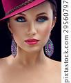 Gorgeous elegant woman in a hat posing in studio 29560797
