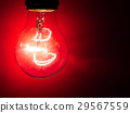 Light bulb at red background 29567559