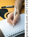 Music Composer Hand Writing Songs 29571434
