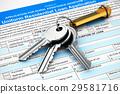 House keys on mortgage or loan application form 29581716