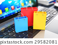 Group of color paper shopping bags on laptop 29582081