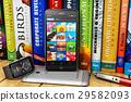 Smartphones and smartwatch on bookshelf 29582093