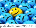 Single happy yellow smiley among blue sad ones 29582113
