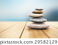 Pile of pebbles on wooden planks 29582129