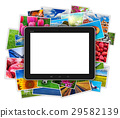 Blank tablet computer on heap of colorful photos 29582139