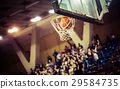 blurred crowd of people in a basketball court 29584735