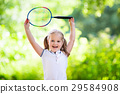 Child play badminton or tennis outdoor in summer 29584908