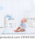Baby boy playing in bedroom 29585560