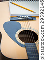 Yellow Acoustic Guitar On Wooden Table 29592146