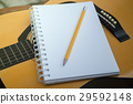 Yellow Acoustic Guitar On Wooden Table 29592148
