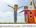 Children in astronauts costumes 29596834