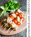Chicken skewers with cherry tomatoes 29601072
