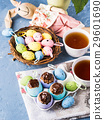 Easter sweet cup cakes treats in egg shell on blue 29601690
