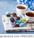 Easter sweet cup cakes treats egg shells on blue 29601691