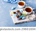 Easter sweet cup cakes treets egg shells on blue 29601694