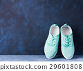Pair of green woman canvas sneakers background 29601808