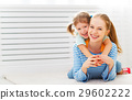 Happy family mother and child hugging and laughing 29602222