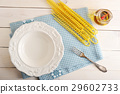 empty plate and ingredients for cooking pasta 29602733