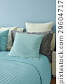 Blue pillows on bed in blue wall bedroom 29604717