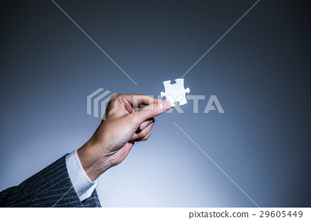 Hand with jigsaw puzzle 29605449