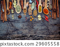Various of spices and herbs in wooden spoons.  29605558