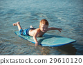 Little boy with surf board learning surfing 29610120