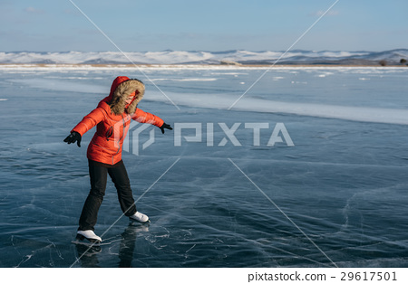 The girl is learning to skate. 29617501