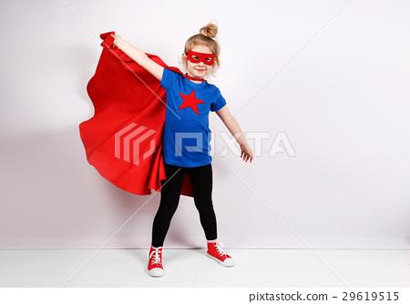 Six year blonde girl dressed like superhero having 29619515