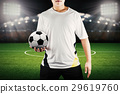 player holding ball with stadium background 29619760