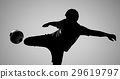 silhouette soccer player kicking the ball 29619797